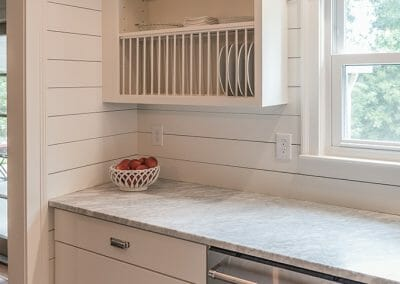 Open shelving and shiplap walls give a vintage feel with modern conveniences in this kitchen remodel in Atlanta