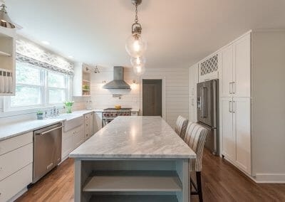 The marble island was painted gray for depth in this kitchen renovation in Atlanta.