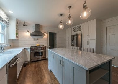 Marble counters and shiplap walls create a farmhouse feeling in this Atlanta kitchen remodel