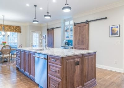 Barn doors, island, and seating area in East Cobb kitchen remodel