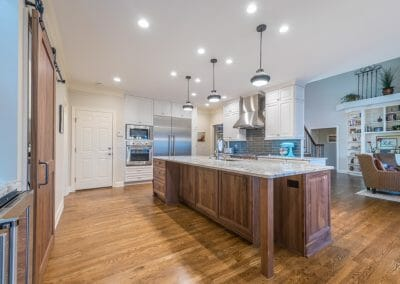 The island is the focal point in this East Cobb kitchen remodeling project