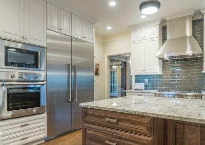 Ovens, refrigerator, backsplash and island in East Cobb kitchen remodeling project