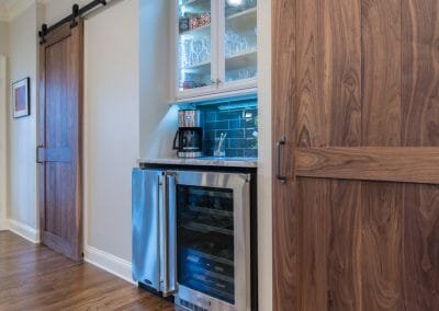 Barn doors and beverage center in East Cobb kitchen remodeling