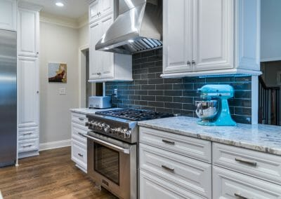 Pro-style range with fashionable gray subway tile backsplash in kitchen remodel in East Cobb
