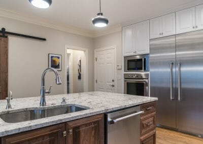 Island and double-door refrigerator in the East Cobb kitchen remodeling project