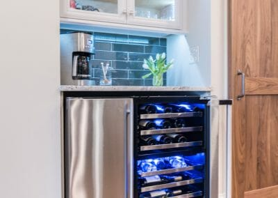 Wine fridge under the coffee counter in East Cobb kitchen remodeling