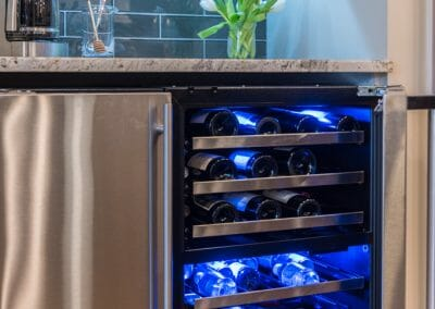Close up of wine and beverage fridge in East Cobb kitchen remodel