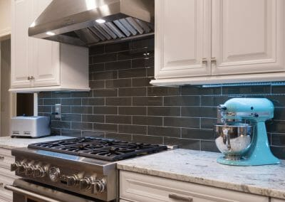 Stylish gray backsplash behind the range and vent hood in East Cobb kitchen remodeling project
