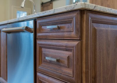 Close up of the warm-toned wooden cabinets in East Cobb kitchen remodeling project
