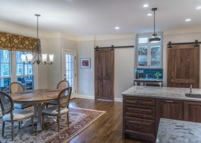 Two barn doors and the eating area in the kitchen remodeling project in East Cobb