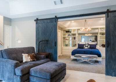 Barn doors open from the sitting room to the bedroom in the master suite remodel in Roswell
