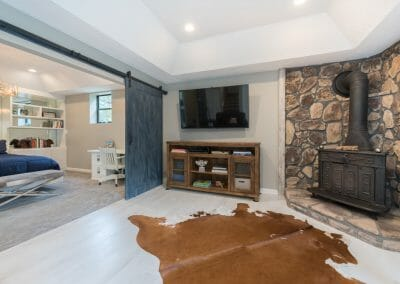 Sitting room divided from bedroom with barn doors in Roswell master suite remodeling