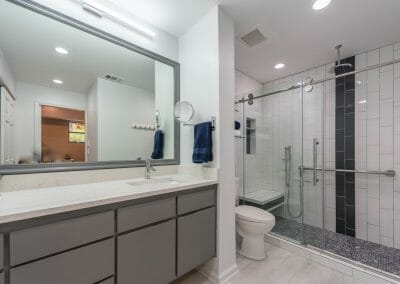 Full view of modern double vanity, tile shower in Roswell master suite remodeling project