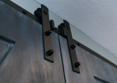 Detail of barn door hardware in master suite remodeling in Roswell