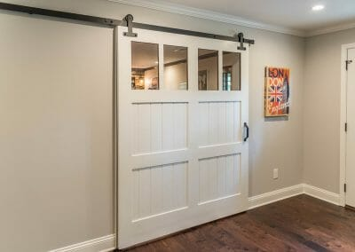 Separating the bar from the home theater in entertainment remodel in East Cobb