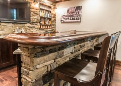 The bar and seating in the basement remodel home bar in East Cobb