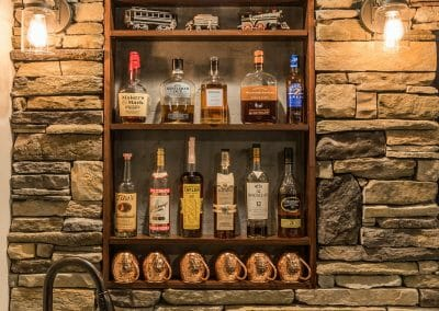 Shelves above the bar sink in basement remodel in East Cobb