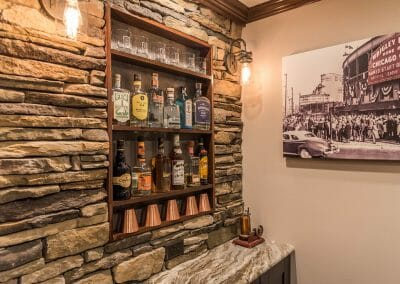 Built-in shelves in the bar back in the home bar basement remodel in East Cobb