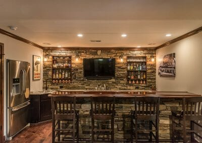 Bar, fridge, and sink in the basement home bar remodel in East Cobb