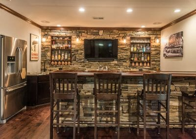 The stone home bar in the remodel in East Cobb by GreatHouse