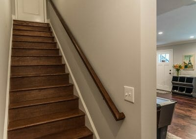 Stairs down to bar room in lower level remodel in East Cobb