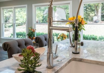 Restaurant-style faucet and farm sink in East Cobb kitchen remodeling project