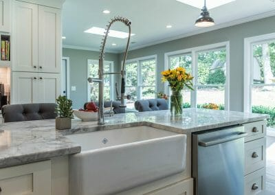 Farm sink and industrial style faucet in kitchen island in East Cobb kitchen remodel