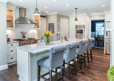 Island, range, and backsplash in East Cobb kitchen remodeling project
