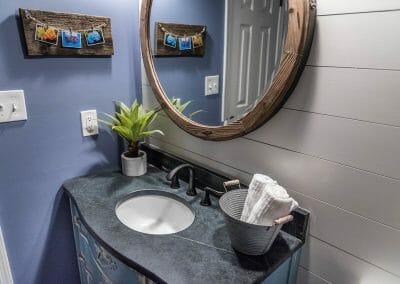 New powder room with repurposed vanity in East Cobb remodel