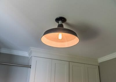 Industrial style light fixture in the East Cobb laundry room