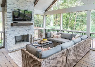 Overlooking the back yard from the seating area in screened porch remodel in East Cobb