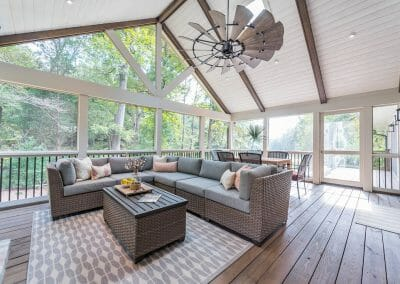 Soaring vaulted ceiling with fan and tongue and groove and beams in screened porch remodel in East Cobb