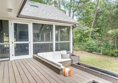 Tiered deck remodel with seating area and screened porch in East Cobb