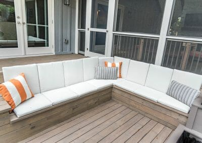 Exterior seating area on new deck with screened porch in East Cobb