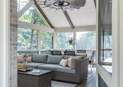 Interior screened porch with vaulted ceiling and ceiling fan