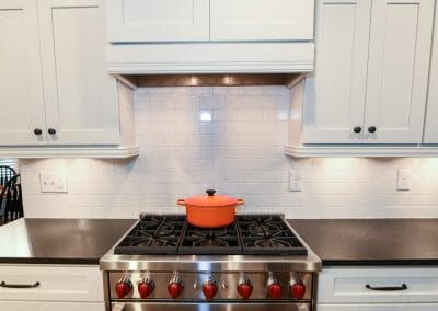 An enclosed vent hood in the East Cobb kitchen remodel