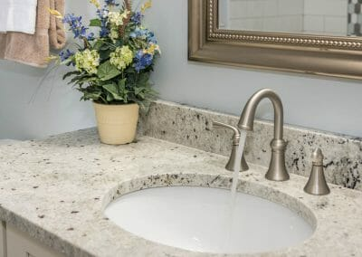 The faucet and sink in the hall bath in the Roswell bathroom remodeling