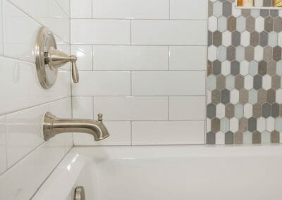 Tile and tub surround in bathroom remodel in Roswell