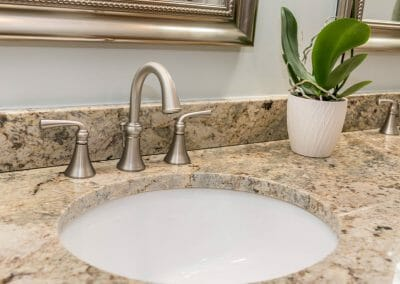 Brushed nickel faucet in Roswell bathroom remodeling project