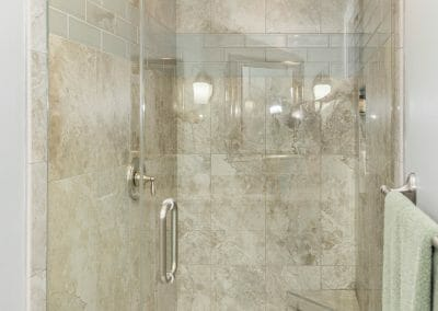 Glass door in the walk-in shower in master bath remodeling in Roswell