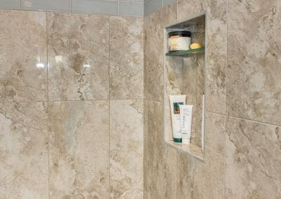 Niche, shelf, and tile detail in master bathroom remodel in Roswell