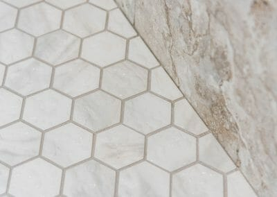 Hex tile floor in the master bathroom shower remodeling project in Roswell
