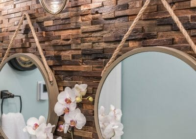 Hanging mirrors, backsplash, and nautical light fixture in the East Cobb bathroom remodel
