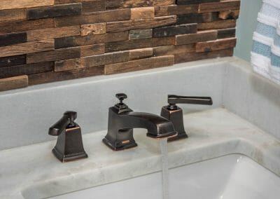 Rubbed bronze faucet in bathroom remodel in East Cobb
