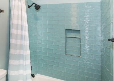 Glass tile and niche in nautical bath remodel in East Cobb