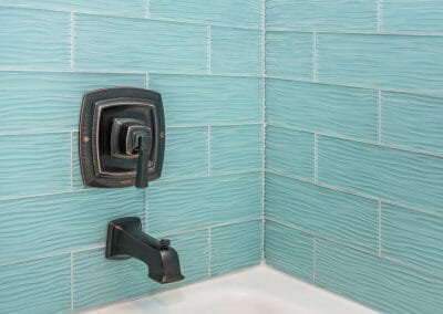 Rubbed-bronze fixtures in the bath remodeling project in East Cobb