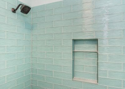 Sea-colored tile shower in nautical bath in East Cobb bathroom remodeling