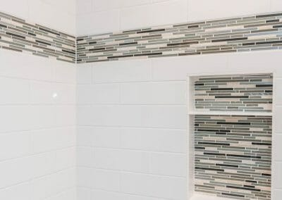 Glass tile and subway tile in master bathroom renovating project in Roswell