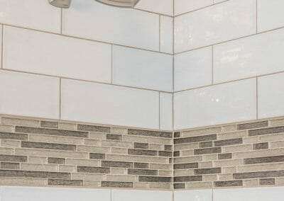 Tile detail and shower head in Roswell bathroom remodeling