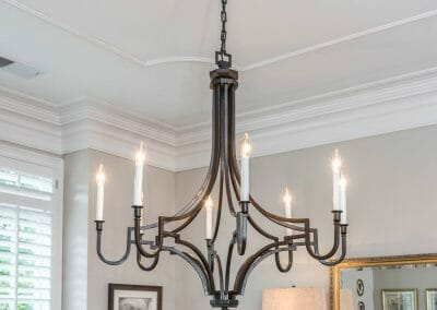 Detail of dining room light fixture with ceiling medallion in East Cobb remodel of first floor